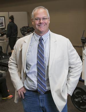 Dr. John Bartholomew in a white lab coat