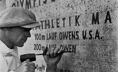 Jesse owens name being carved into a wall