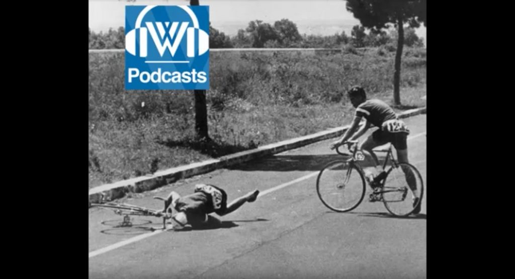 a biker who fell over with another biker looking over him