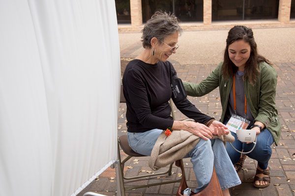 A student taking a patient's blood pressure