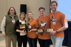TACSM President Scott Davis and Faculty Sponsor Michelle Harrison with winning team members Maria Hadjimarcou, Hayden Rich, and Cameron Vaughan.