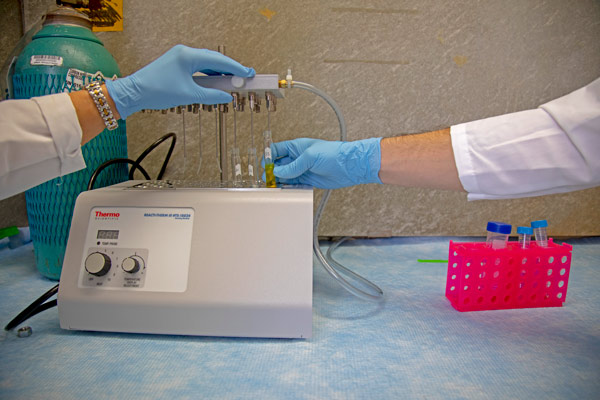 Two researchers handling medical equipment